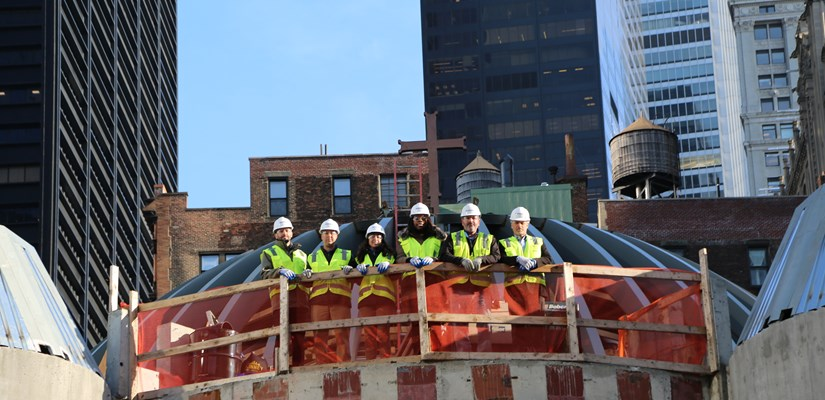 Skanska USA team members celebrate the topping out of the St. Nicholas Greek Orthodox Church and National Shrine, representing the completion of the structural steel erection at the site.