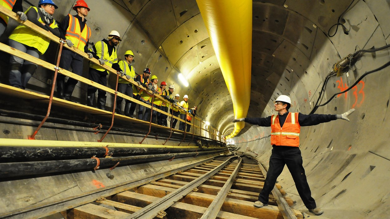 management-talking-shop-in-subway-tunnel