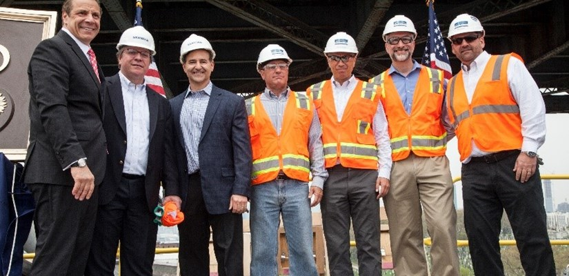 Skanska and Kiewit executives and Governor Andrew Cuomo celebrate the grand opening of the Queens-bound span of the new Kosciuszko Bridge on April 27, 2017.