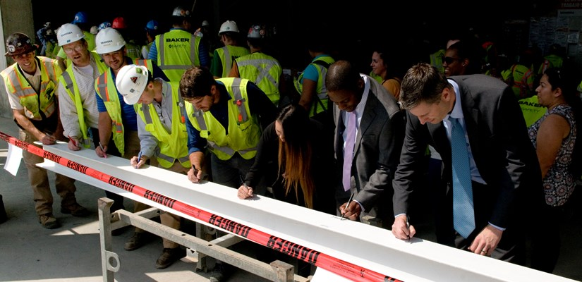 The DC team signs final beam at topping out of 99M Street.