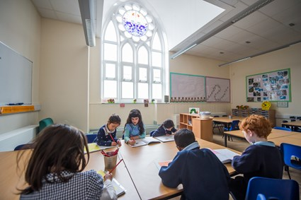 Reinstated stained glass windows bring light and colour to the refurbished classrooms of St Werburghs Primary