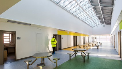 Light and bright communal space in a cell block at HMP Grampian